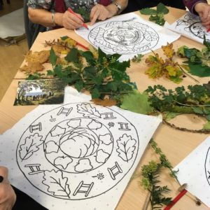 Making a drawing using leaves