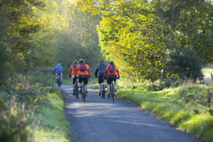 Five cyclists on country road