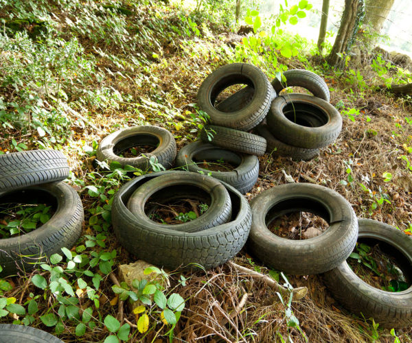 Pile of car tyres in the countryside