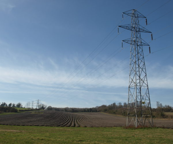 Electricity pylon in a field